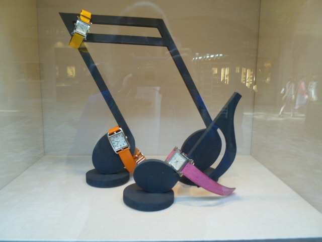 whimiscal way to display watches at Hermes.