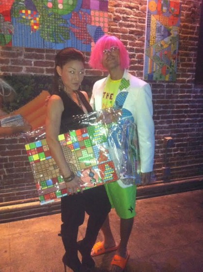 Elliot and friend model Jago repurposed clothing while parading with Jago paintings.
