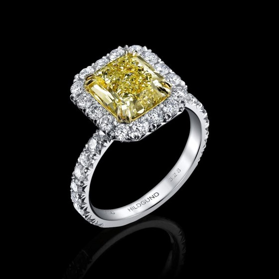 Custom hand crafted 18k yellow and white gold Natural Fancy internally flawless 3.28 carat yellow diamond with 54 round brilliant cut diamonds.