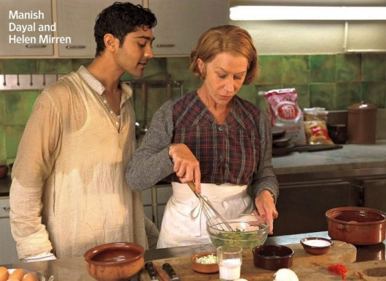 Manish Dayal and Helen Mirren in the kitchen.