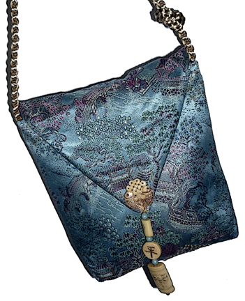 This bag started out as a custom made cheongsam from one of Cora Yee's aunties.