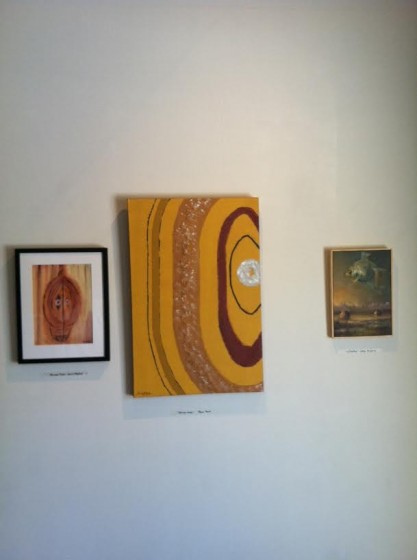 Rather than bunching each artist's work together in a group, we chose to intersperse the paintings.