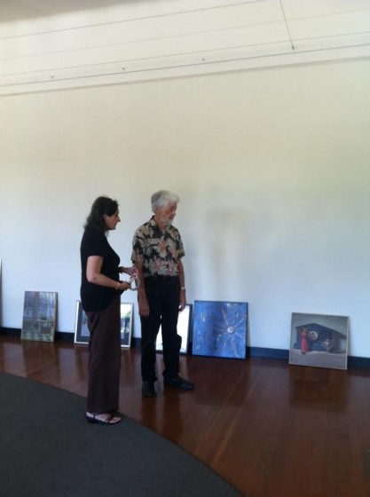 Snowden and Paula Hodges consider how to place the paintings to their best advantage.
