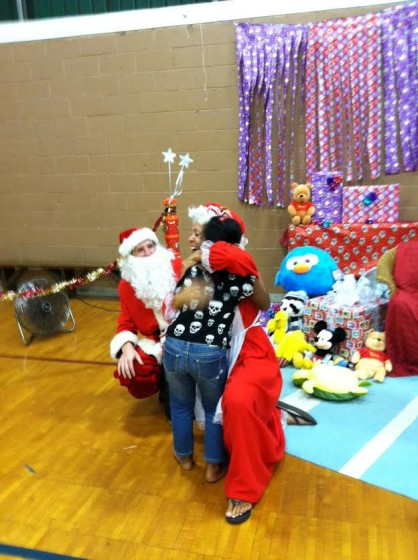 Mrs. Santa had a hug for every keiki.