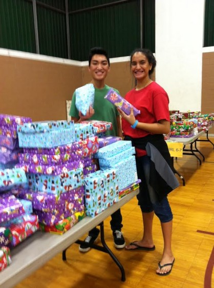 Palama scholarship students serve as Santa's elves.