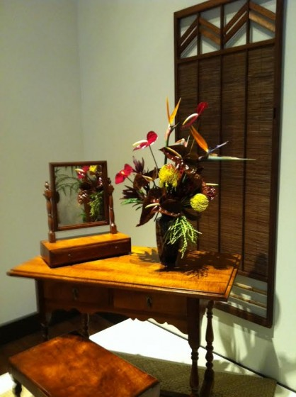 The is floral arrangement perfectly complements the lines, colors, shapes and textures of the interior design.