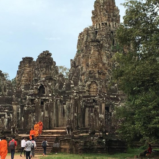 Buddhist monks head to Angkor Thom Temple for prayers.