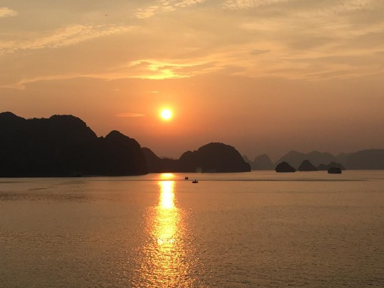 The sun sets on Ha Long Bay. All photos in this story are by Jerry Mayfield.