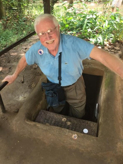 Jerry emerges triumphant from a tunnel in Cu Chi.
