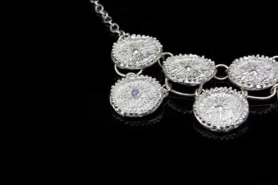 """The """"double decker"""" necklace is blessed with a little gemstone."""