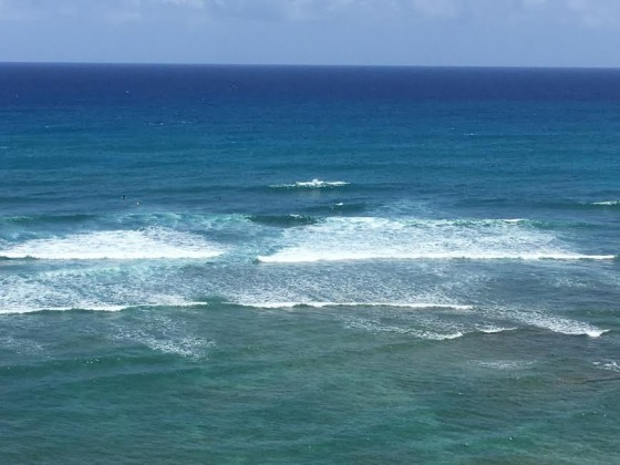 A pause by the road to enjoy this incredible vista of sea and surfers.