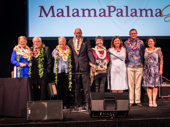 The RAth family accepts a Malama Palama trophy on the stage at the Sheraton Waikiki HOtel. L to R: Paula (with trophy), Jerry Mayfield, Roberta Cullen, Jim Cullen