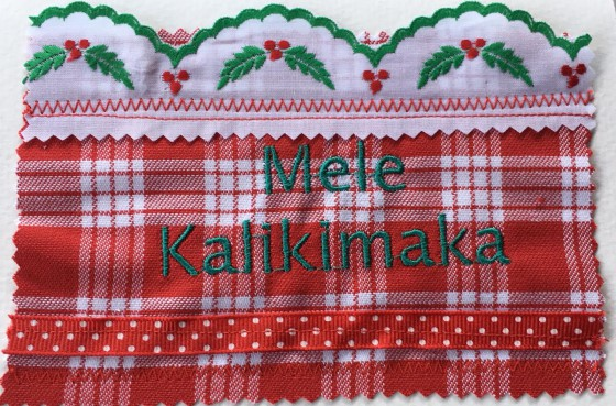 This embroidered Swiss trim is absolutely beautiful. And who can resist a palaka card with Hawaiian language? Make your Mainland friends green with envy!